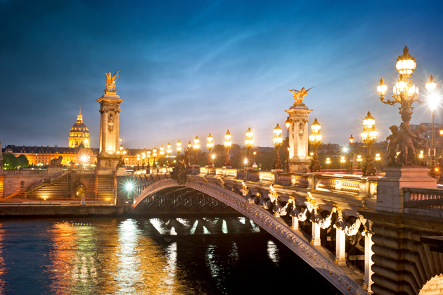 Stand atop the Alexander III Bridge in Paris