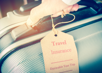 hands-holding-travel-insurance-tag