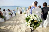 Seashell bouquets and starfish decor set the mood for a beach wedding